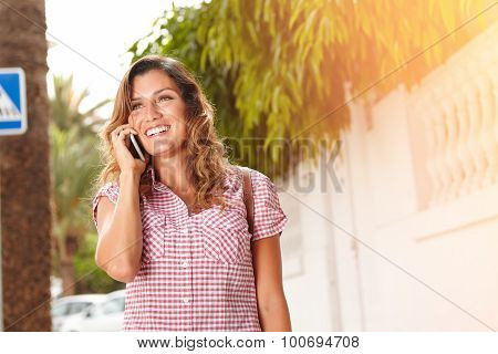 Young Woman Smiling While Talking On Cell Phone