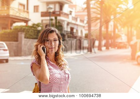Young Woman Looking At The Camera While Walking