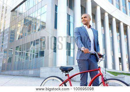 Nice man holding bicycle