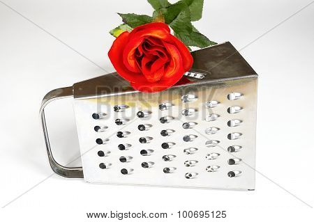 Kitchen Grater With Red Rose On A White Background