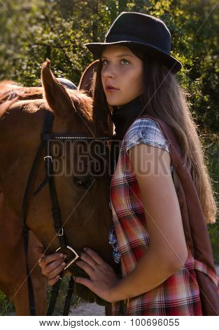 Cowgirl In Hat With Bay Horse
