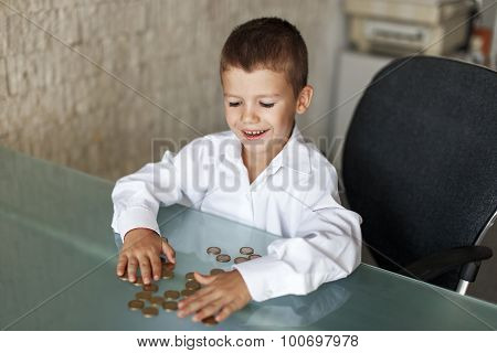 Little Boy With One Euros On Table