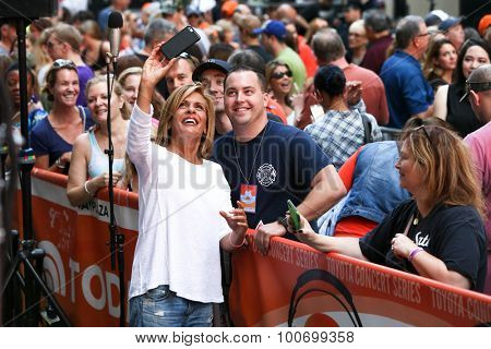 NEW YORK-SEP 4: TV personality Hoda Kotb (L) takes a selfie with a fan as Brad Paisley (not pictured) performs at NBC's TODAY Show at Rockefeller Plaza on September 4, 2015 in New York City.