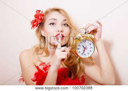 Blonde woman with alarm-clock