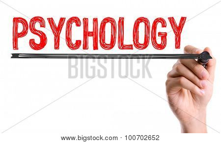 Hand with marker writing the word Psychology