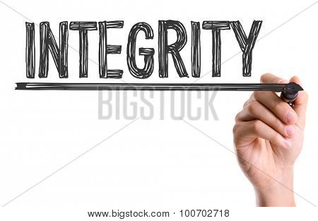 Hand with marker writing the word Integrity