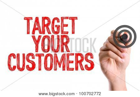 Hand with marker writing the word Target Your Customers