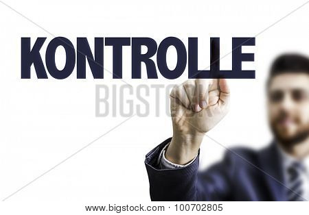 Business man pointing the text: Control (in German)