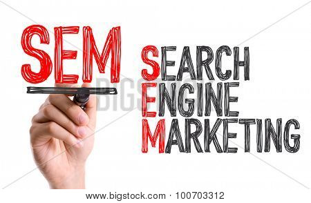 Hand with marker writing the word Search Engine Marketing