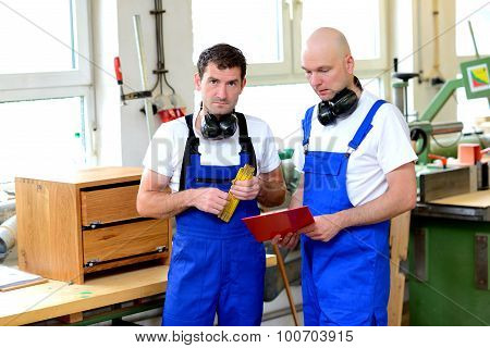 Two Worker In A Carpenter's Workshop