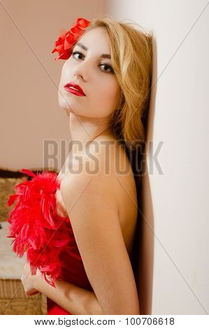Girl in red dress with flower barrette and feather boa