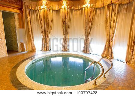Novi Petrivtsi, Ukraine - May 27, 2015 Mezhigirya residence of ex-president of Ukraine Yanukovich. Luxurious room with small swimming pool