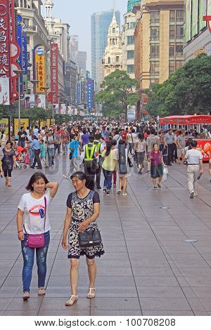people are walking on pedestrian street in Shanghai, China