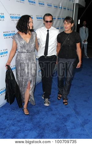 LOS ANGELES - AUG 29:  Joaquin Phoenix, Summer Phoenix, Rain Phoenix at the Mercy For Animals Hidden Heroes Gala at the Unici Casa on August 29, 2015 in Culver City, CA
