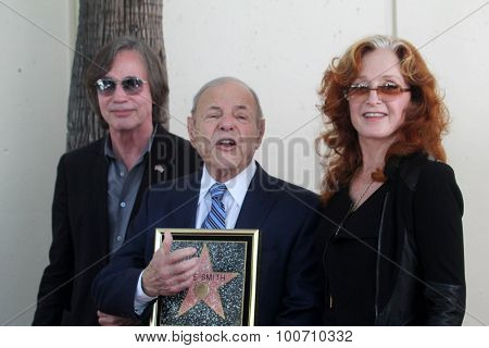LOS ANGELES - AUG 27:  Jackson Browne, Joe Smith, Bonnie Raitt at the Joe Smith Star on the Hollywood Walk of Fame at the Capital Records Building on August 27, 2015 in Los Angeles, CA