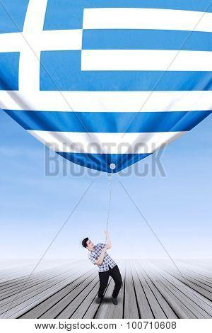 Caucasian Person Bring Down A Greece Flag
