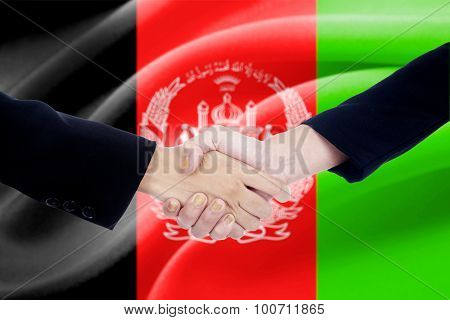 Handshake With Afghanistan Flag Background
