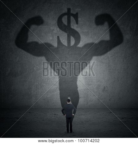 Man With A Shadow Of Athlete And Dollar Sign