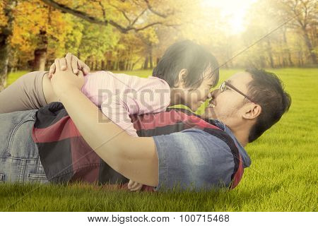 Playful Girl With Her Dad At The Park