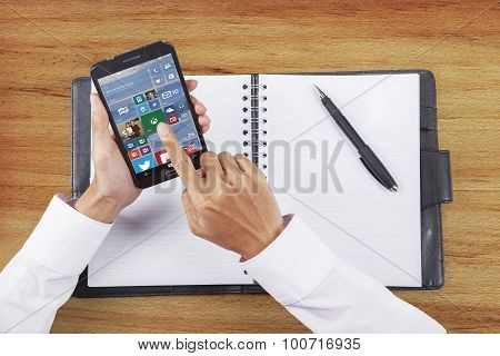 Worker Using App Of Windows 10 On Cellphone