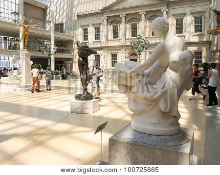 NEW YORK,USA- AUGUST 18,2015 : Visitors admiring classic sculptures at the Metropolitan Museum of Art in Manhattan