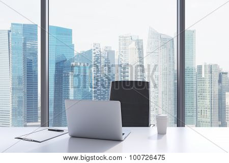 A Workplace In A Modern Panoramic Office With Singapore View. A White Table, Black Leather Chair. La