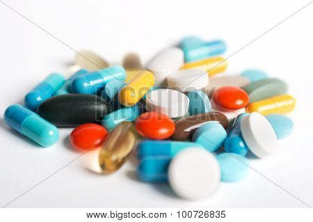 Coloured Pills And Capsules On White Background.