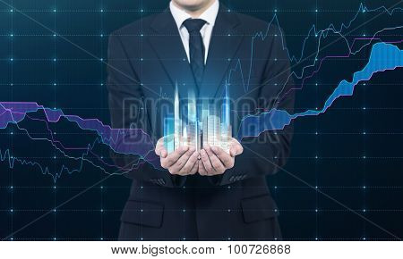 A Person Holds A Hologram Of Skyscrapers As A Symbol Of Financial Success. Forex Chart As A Part Of