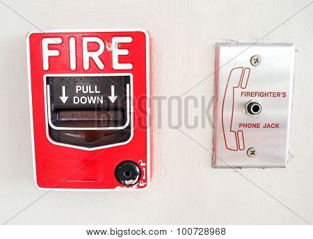 Fire alarm switch on wall for emergency.