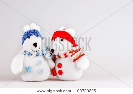 Pair Of Cute Plush Rabbits In Warm Clothes. Sweet Couple Of Toys In Scarfs And Caps.