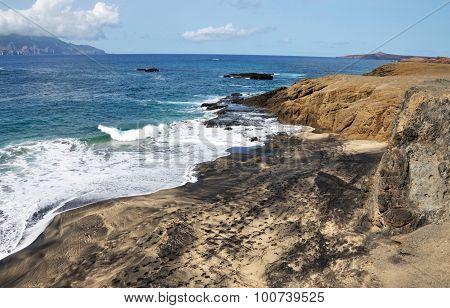 Waves On A Mixed Sand Beach