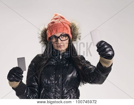 woman with two credit cards