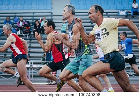 competition old men athletes at the distance of 100 meters