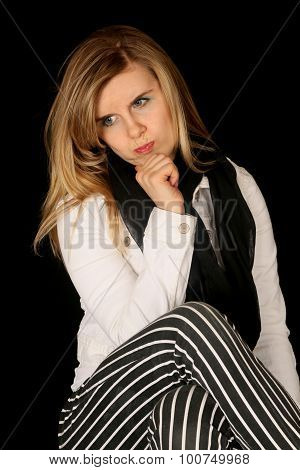 Woman Wearing Black Striped Pants Sitting Hand On Chin Pondering
