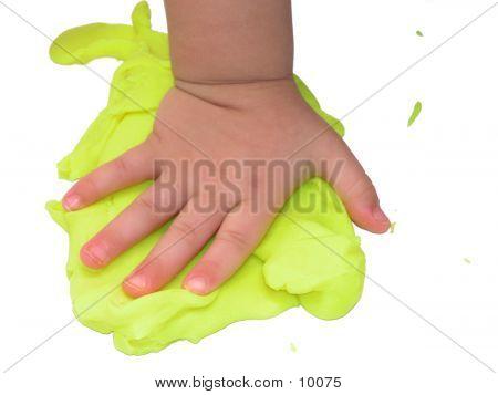 Child's Hand In Playdoah