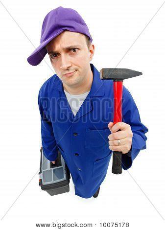 Awkward repairman with hammer