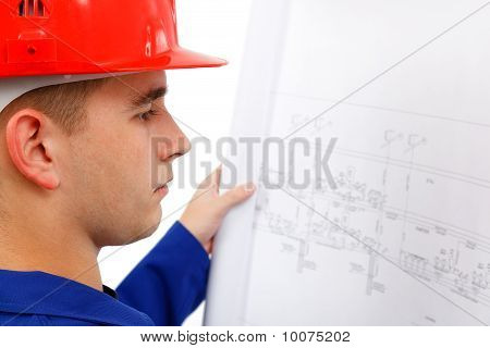 Young Construction Engineer Surveying Plans