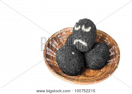 Salted eggs in rattan basket with sad face