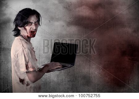 Scary Male Zombie Typing With Laptop