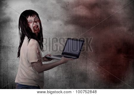 Creepy Female Zombie Typing With Laptop