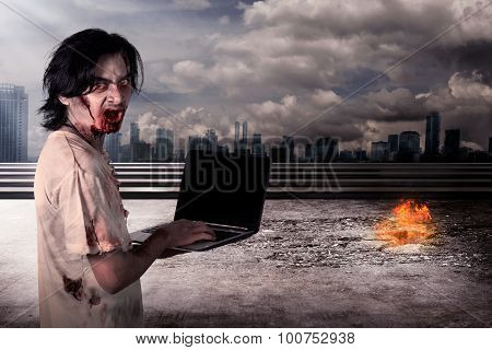 Creepy Male Zombie Typing With Laptop