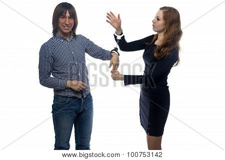 Man and angry woman with handcuffs