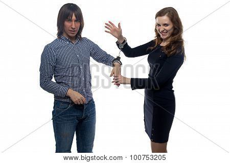 Man and gloating woman with handcuffs