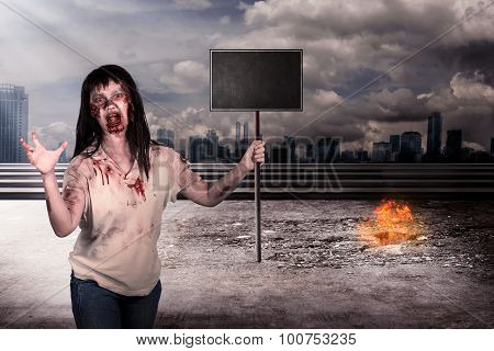 Female Zombie Holding Wooden Board Over City On Fire