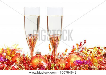 Glasses Of Champagne And Red And Orange Xmas Balls