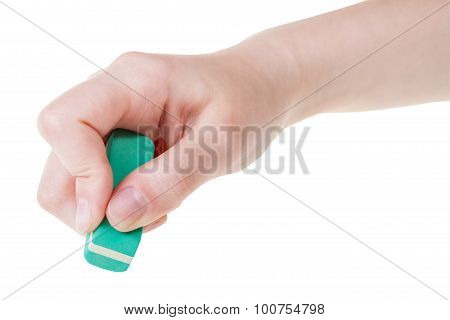 Hand With Green New Rubber Eraser Close Up