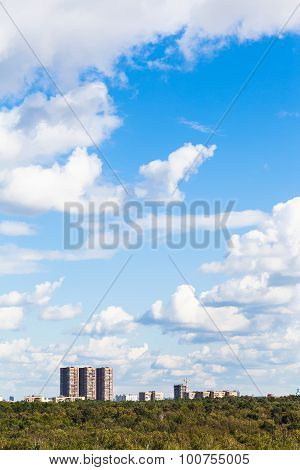 Blue Sky With White Clouds Over Urban Buildings