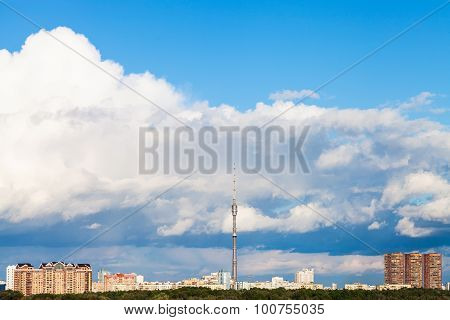 Large Cloud In Blue Sky Over City With Tv Tower