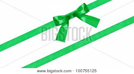 Green Bow Knot On Two Diagonal Silk Bands Isolated