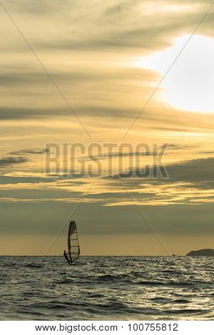 Windsurfer Silhouette Against A Sunset